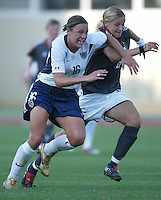 23 August 2004:  Abby Wambach in action against Germany during the semifinal game at Pankritio Stadium in Heraklio, Greece.     USA defeated Germany, 2-1 in overtime.   Credit: Michael Pimentel / ISI