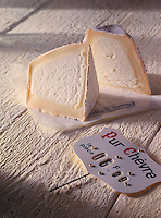 "2 halves of Pyramid Chevre cheese with ""pur Chevre"" sign"