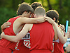 The Mineola boys' 4x800 relay team huddles together before the race in Day Two of the Nassau County individual championships and state qualifiers at Cold Spring Harbor High School on Friday, June 5, 2015.<br /> <br /> James Escher