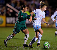 St Louis Athletica midfielder Lisa Stoia (7) pressures Chicago Red Stars forward Ella Masar (3). Saint Louis Athletica were defeated 1-0 by Chicago Red Stars in which was both teams inaugural game, played at Korte Stadium, Edwardsville, Illinois on April 4, 2009. Photo by Scott Rovak /isiphotos.com