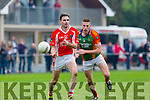 Alan macgearailt West Kerry releases his pass under pressure from Thomas Ladden Mid kerry during their County Championship clash in Beaufort on Saturday