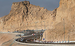 The peloton enter the mountains during Stage 3, The Al Ain Stage, of the 2015 Abu Dhabi Tour starting from the Al Qattara Souq in Al Ain and running 129 km to the mountain top finish at Jebel Hafeet at 1025 metres, Abu Dhabi. 10th October 2015.<br /> Picture: ANSA/Claudio Peri | Newsfile