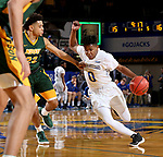 BROOKINGS, SD - FEBRUARY 1: Brandon Key #0 from South Dakota State University drives to the basket against Cameron Hunter #22 from North Dakota State University during their game Thursday at Frost Arena in Brookings. (Photo by Dave Eggen/Inertia)