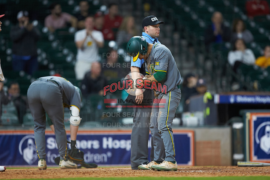 Ricky Martinez (11) of the Baylor Bears reacts after scoring a run during the game against the Arkansas Razorbacks in game nine of the 2020 Shriners Hospitals for Children College Classic at Minute Maid Park on March 1, 2020 in Houston, Texas. The Bears defeated the Razorbacks 3-2. (Brian Westerholt/Four Seam Images)
