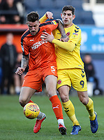 Fleetwood Town's Ched Evans competing with Luton Town's Sonny Bradley<br /> <br /> Photographer Andrew Kearns/CameraSport<br /> <br /> The EFL Sky Bet League One - Luton Town v Fleetwood Town - Saturday 8th December 2018 - Kenilworth Road - Luton<br /> <br /> World Copyright &copy; 2018 CameraSport. All rights reserved. 43 Linden Ave. Countesthorpe. Leicester. England. LE8 5PG - Tel: +44 (0) 116 277 4147 - admin@camerasport.com - www.camerasport.com