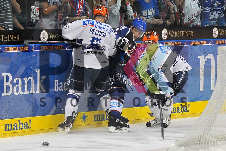Mannheim 02.10.12, DEL, Adler Mannheim - Iserlohn Roosters, Mannheims Marcel Goc (Nr.9) gegen Iserlohns Derek Peltier (Nr.5) und Iserlohns Mark Ardelan (Nr.12) <br /> <br /> Foto &copy; Ice-Hockey-Picture-24 *** Foto ist honorarpflichtig! *** Auf Anfrage in hoeherer Qualitaet/Aufloesung. Belegexemplar erbeten. Veroeffentlichung ausschliesslich fuer journalistisch-publizistische Zwecke. For editorial use only.