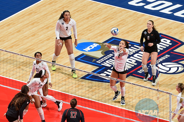 COLUMBUS, OH - DECEMBER 17:  Micaya White (1) of the University of Texas hits the ball over the net against Stanford University during the Division I Women's Volleyball Championship held at Nationwide Arena on December 17, 2016 in Columbus, Ohio.  Stanford defeated Texas 3-1 to win the national title. (Photo by Jamie Schwaberow/NCAA Photos via Getty Images)