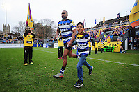 Aled Brew of Bath Rugby, mascot in hand, runs out onto the field. Aviva Premiership match, between Bath Rugby and Saracens on December 3, 2016 at the Recreation Ground in Bath, England. Photo by: Patrick Khachfe / Onside Images