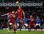 01.02.2020 Rangers v Aberdeen: Ash Taylor gets to the ball ahead of Alfredo Morelos
