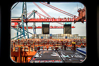 Cranes load containers onto the Mary Maersk, the largest container ship in the world.