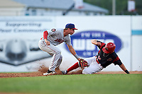 Auburn Doubledays second baseman Branden Boggetto (3) attempts to tag Matthew Brooks (46) sliding in safely after a wild pitch during a game against the Batavia Muckdogs on June 19, 2017 at Dwyer Stadium in Batavia, New York.  Batavia defeated Auburn 8-2 in both teams opening game of the season.  (Mike Janes/Four Seam Images)