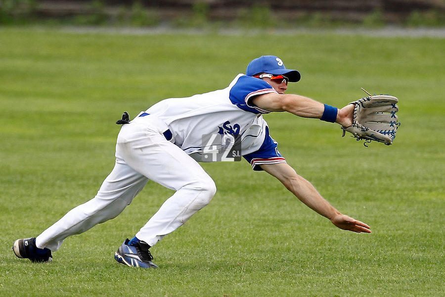 23 June 2011: Joris Bert of Team France is seen diving for a ball during USSSA 5-3 win over France, at the 2011 Prague Baseball Week, in Prague, Czech Republic.