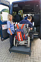 Disabled person using the van wheelchair lift with the help from his carer. This image may only be used to portray the subject in a positive manner..©shoutpictures.com..john@shoutpictures.com