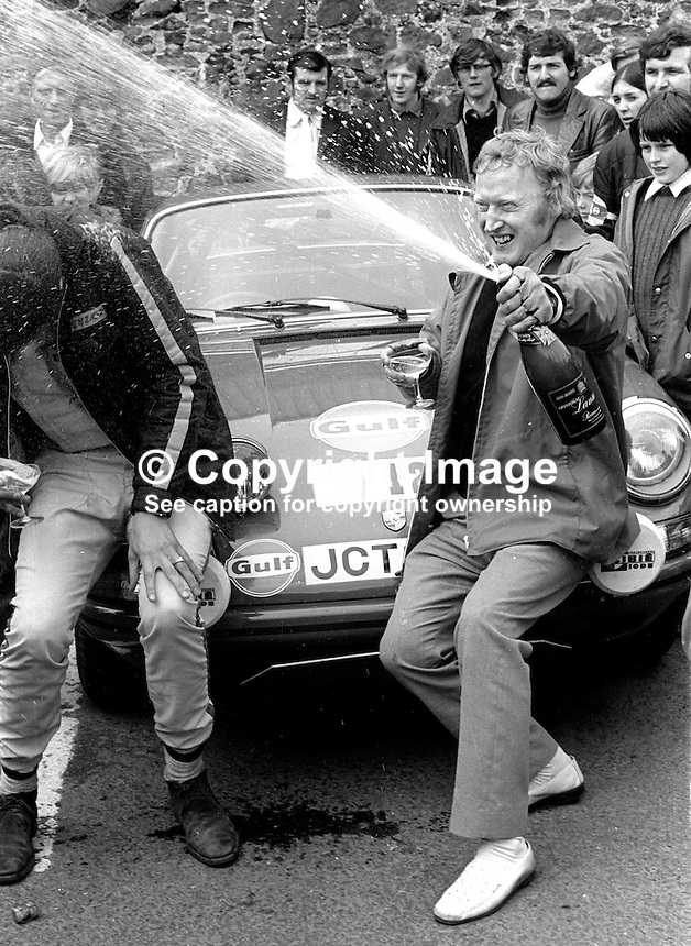 Jubilant Jack Tordoff, right, celebrates winning 1973 Circuit of Ireland Motor Rally. 24th April 1973. His co-driver Phil Short tries to avoid the spray. 197304240217e<br />