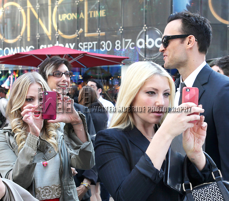 """The cast and creative team of """"The Performers"""", from left, actress Jenni Barber, actress Ari Graynor, producer Robyn Goodman and actor Cheyenne Jackson attends press event to introduce the cast and creators of the new Broadway play """"The Performers""""at the Hard Rock Cafe on Tuesday, Sept. 25, 2012 in New York."""