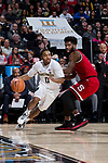 Brandon Childress (0) of the Wake Forest Demon Deacons drives the baseline past Lennard Freeman (1) of the North Carolina State Wolfpack during first half action at the LJVM Coliseum on February 17, 2018 in Winston-Salem, North Carolina.  The Wolfpack defeated the Demon Deacons 90-84.  (Brian Westerholt/Sports On Film)