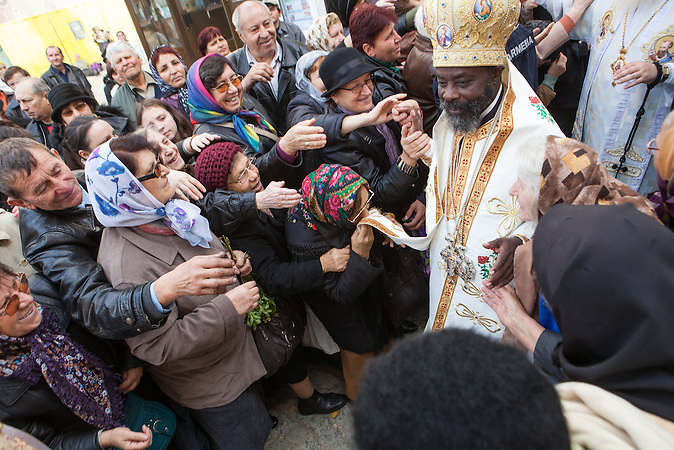 His Eminence Innocent Bishop of Burundi and Rwanda bless the pilgrims gathered in the court yard of the Metropolitan Cathedral of Iasi, during the Mess dedicated to Saint Parascheva, October 14, 2013.