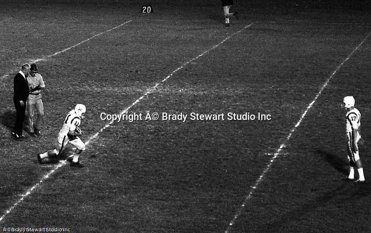 Bethel Park PA:  Mike Stewart 11 and Scott Streiner warming up before the first game against Baldwin - 1970. Head Coach Rudy Andabaker and Athletic Director Joe Lodge in the background. After Scott Streiner was injuried on the first play, the team rallied and came up just short of winning the game when they missed a two-point conversion late in the 4th quarter (7-6).  Defensive unit was one of the best in Bethel Park history only allowing a little over 7 points a game.  The 1970 team had more players winning 4-years scholarships than any other class. Division 1:  Dennis Franks (Michigan), Mike Stewart and Joe Barrett (William & Mary), Scott Streiner and Glenn Eisaman (Cincinnati), Division 2: Jim Dingeldine (West Liberty), Clark Miller (Clarion).