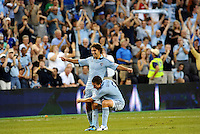 Graham Zusi (8) midfielder Sporting KC and Matt Besler (5) defender Sporting KC celebrate the opening goal....... Sporting Kansas City defeated Portland Timbers 3-1 at LIVESTRONG Sporting Park, Kansas City, Kansas.