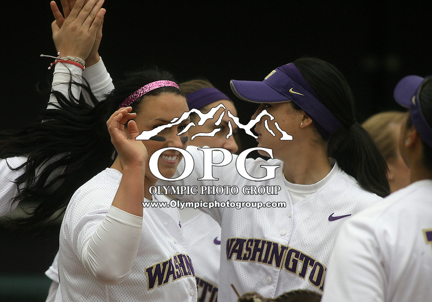 23 May 2010:  Washington Huskies pitcher Danielle Lawrie and fellow players celebrate after the game against the University of North Carolina.  Washington defeated the University of North Carolina 2-1 in eight innings at Husky Softball Stadium in Seattle, WA to advance in the NCAA regional tournament.