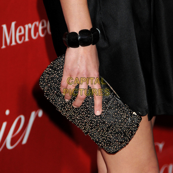 MARION COTILLARD's hand .Palm Springs International Film Festival Awards Gala 2010 held at the Palm Springs Convention Center, Palm Springs, California, USA, .5th January 2010..black detail hand clutch bag bracelet .CAP/ADM/BP.©Byron Purvis/AdMedia/Capital Pictures.