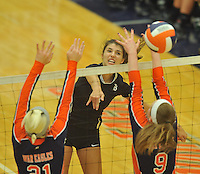 NWA Democrat-Gazette/MICHAEL WOODS • @NWAMICHAELW<br /> Bentonville's Sadie Pate tries to hit the ball past Heritage defenders during their game Tuesday September 22, 2015 at Heritage High School.