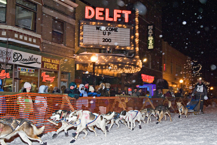 Race scene in downtown Marquette Michigan during the start of the UP 200 Sled Dog Championship race.