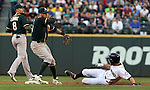 Oakland Athletics second baseman Eric Sogard (28) turns a double play against the Seattle Mariners in the fourth inning September 13, 2014 at Safeco Field in Seattle.  Being forced out at second is Kendrys Morales.   The Athletics beat the Mariners 3-2 when Mariners pitcher Fernando Rodney  walked in Coco Crisp in the 10th inning.  ©2014. Jim Bryant Photo. All Rights Reserved.