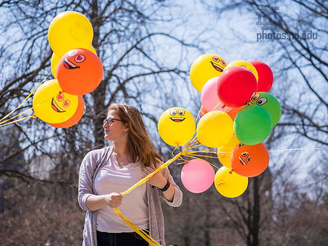 "Apr. 14, 2016; Vivian Crumlish '19 waits to hand out balloons to passers-by outside LaFortune. Crumlish is a member of the KiND club, whose purpose is to perform random acts of kindness. ""Making people smile is one of the best things you can do,"" said Crumlish. (Photo by Matt Cashore/University of Notre Dame)"