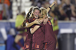 06 December 2013: Virginia Tech's Ashley Meier (15) celebrates her goal with teammates Ashley Manning (12) and Kelsey Loupee (9). The Florida State Seminoles defeated the Virginia Tech University Hokies 3-2 at WakeMed Stadium in Cary, North Carolina in a 2013 NCAA Division I Women's College Cup semifinal match.