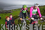 Jack and Diarmuid O'Donoughue watch John Crowley and Denis O'Shea at the new downhill Mountain bike track in Glenflesk.