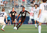 Boyzzz Khumalo #17 of D.C. United cuts between Jason Pelletier #22 and Jerrit Thayer #16 of the Harrisburg City Islanders during a US Open Cup match at the Maryland Soccerplex on July 21 2010, in Boyds, Maryland. United won 2-0.