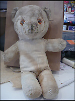BNPS.co.uk (01202 558833)<br /> Pic: AlicesBearShop/BNPS<br /> <br /> Mary Thompson's bear after her surgery.<br /> <br /> Broken bears and deteriorating dolls from all over the world are being brought back to life by a UK team of dedicated doctors and nurses at one of the last remaining toy hospitals.<br /> <br /> The team at Alice's Bear Shop, a teddy bear and doll hospital in Lyme Regis, Dorset, perform all kinds of 'surgery' from simple restringing and re-stuffing to head re-attachments and complete skin grafts.<br /> <br /> Rikey Austin, 49, opened the hospital in January 2000 but also ran a shop and only repaired one or two toys a month.<br /> <br /> Now she has a four-month waiting list for patients and has had to close the shop to focus on the hospital side of the business.