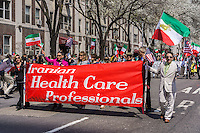 Members of the Iranian Health Care Professionals affinity group march the 11th annual Persian Parade on Madison Ave. in New York on Sunday, April 13, 2014. The parade celebrates Nowruz, New Year in the Farsi language. The holiday symbolizes the purification of the soul and dates back to the pre-Islamic religion of Zoroastrianism. (© Richard B. Levine)