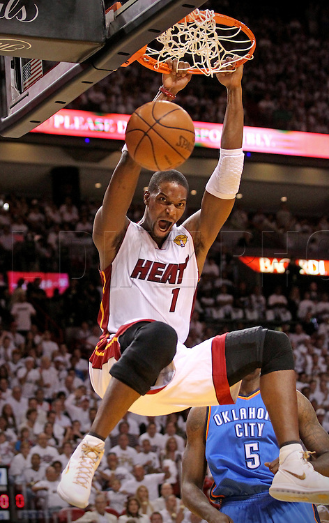 Chris Bosh dunks in the first quarter during Game 3 of the NBA Finals between the Miami Heat and the Oklahoma City Thunder at AmericanAirlines Arena on Sunday, June 17, 2012.