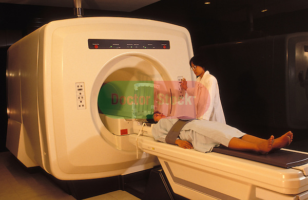 Woman being prepared for cat scan in hospital.  Indonesia.