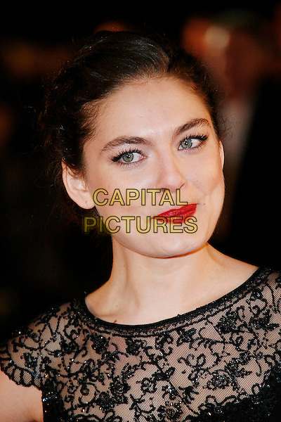 "ALEXA DAVALOS.Attending the European Film Premiere of ""Defiance"" at  Odeon Leicester Square, London, England, January 6th 2009..portrait headshot red lipstick black sheer lace hair up .CAP/DAR.©Darwin/Capital Pictures"