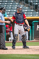 John Hicks (6) of the Tacoma Rainiers on defense against the Salt Lake Bees in Pacific Coast League action at Smith's Ballpark on May 7, 2015 in Salt Lake City, Utah. The Bees defeated the Rainiers 11-4 in the completion of the game that was suspended due to weather on May 6, 2015. (Stephen Smith/Four Seam Images)