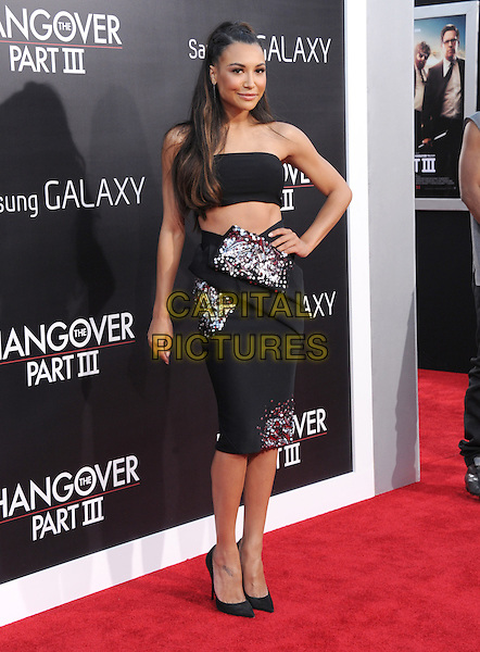 "Naya Rivera.""The Hangover Part III"" Los Angeles Premiere held at the Westwood Village Theater, Los Angeles, California, USA..May 20th, 2013.full length black strapless dress top skirt cropped cut out away hand on hip embellished jewel encrusted  hand on hip belly stomach midriff.CAP/DVS.©DVS/Capital Pictures"