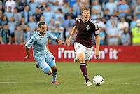 Rapids defender Scott Palguta (29) goes past Graham Zusi..Sporting Kansas City defeated Colorado Rapids 2-0 in Open Cup play at LIVESTRONG Sporting Park, Kansas City, Kansas.