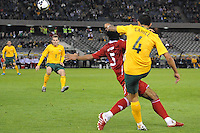 MELBOURNE, AUSTRALIA - OCTOBER 14: Tim Cahill from Australia kicks the ball in a AFC Asian Cup 2011 match between Australia and Oman at Etihad Stadium on October 14, 2009 in Melbourne, Australia. Photo Sydney Low www.syd-low.com