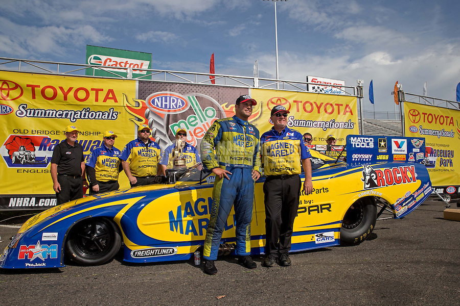 Jun. 2, 2013; Englishtown, NJ, USA: NHRA funny car driver Matt Hagan celebrates with crew chief after winning the Summer Nationals at Raceway Park. Mandatory Credit: Mark J. Rebilas-