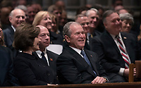 December 5, 2018 - Washington, DC, United States: Former President George W. Bush enjoys a moment of levity during the state funeral service of his father, former President George W. Bush at the National Cathedral.  <br /> <br /> CAP/MPI/RS<br /> &copy;RS/MPI/Capital Pictures