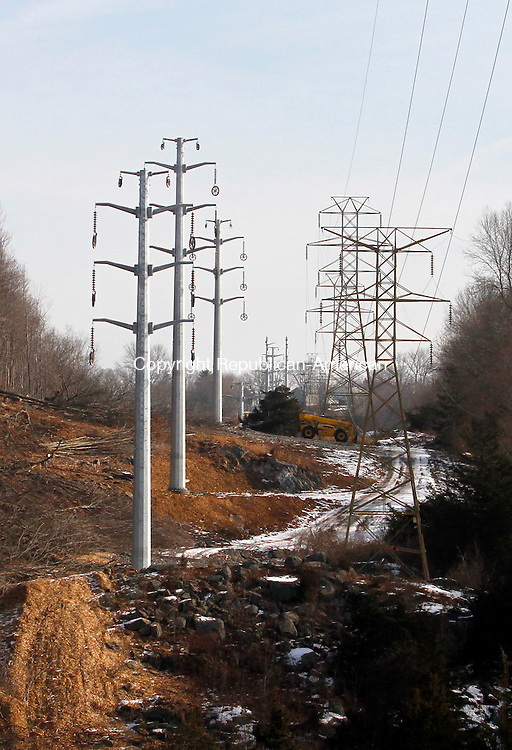 MIDDLEBURY, CT.- 01 FEBRUARY 2014 - 020114JW03 - New electrical transmission line poles rise up next to old ones near Route 63 as part of the transmission line upgrade that Northeast Utilities is doing from Watertown to Sherman.<br /> Jonathan Wilcox Republican-American
