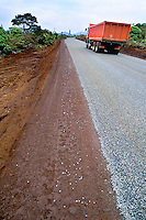 Truck driving on a newly asphalted road, Prony Bay, New Caledonia.