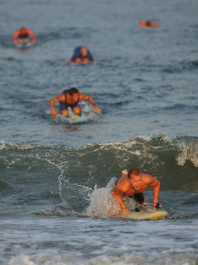 Lifeguards compete during the 1000-Meter Paddleboard event at the First Annual Asbury Park Beach Bar Lifeguard Competition held at the 3rd Avenue beach.  ASBURY PARK, NJ  8/4/07  8:21:47 PM  PHOTO BY ANDREW MILLS
