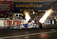 Apr 7, 2006; Las Vegas, NV, USA; NHRA Top Fuel driver Larry Dixon in the Miller Lite dragster races during qualifying for the Summitracing.com Nationals at Las Vegas Motor Speedway in Las Vegas, NV. Mandatory Credit: Mark J. Rebilas