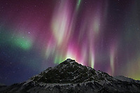 Northern lights over mount Dillon, Brooks Range mountains in Alaska's Arctic.