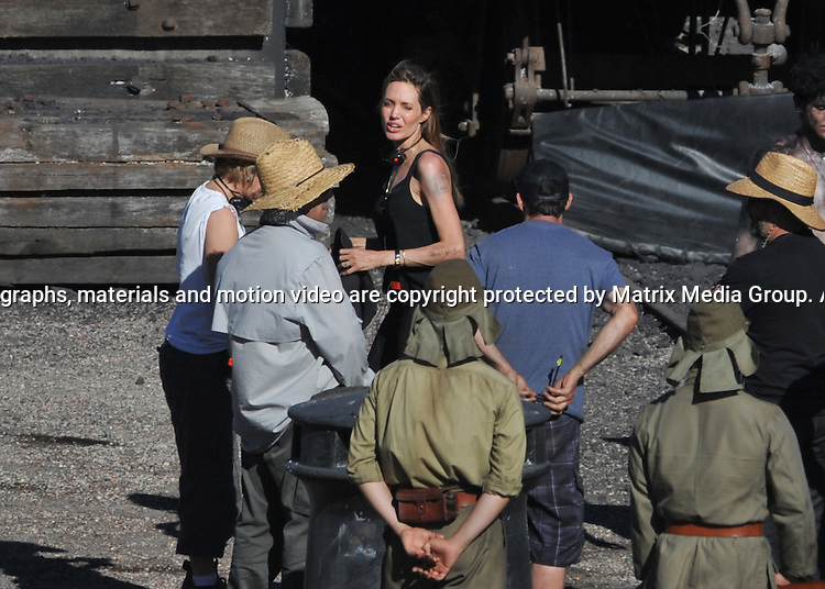 2 DECEMBER  2013 SYDNEY AUSTRALIA<br /> <br /> EXCLUSIVE PICTURES<br /> <br /> Angelina Jolie pictured at work on the set of 'Unbroken' at Cockatoo Island. Angelina dressed from head to toe in her usual 'black' work clothes and looking as bonny as a Prisoner of War showed what a dynamic director she is as she literally threw herself into her work. Angelina took a hands on approach to demonstrating what she wanted from the actor in the scene. <br /> <br /> *No internet without clearance*.<br /> MUST CALL PRIOR TO USE <br /> +61 2 9211-1088. <br /> <br /> Matrix Media Group.Note: All editorial images subject to the following: For editorial use only. Additional clearance required for commercial, wireless, internet or promotional use.Images may not be altered or modified. Matrix Media Group makes no representations or warranties regarding names, trademarks or logos appearing in the images.