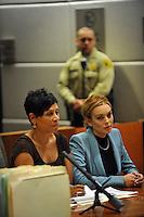 Lindsay Lohan llega en un traje de Givenchy azul y gris con Celine_bag por su informe final el progreso de libertad condicional en la corte de Los Angeles, California, el 29.03.2012. Los Ángeles, juez del Tribunal Superior Stephanie_Sautner decidió levantar la libertad condicional de Lohan de su infame caso de conducir ebrio steming a partir de 2007, por lo que ella ya no tienen que reunirse con un oficial de libertad condicional o de comparecer ante el tribunal en su caso, robo de 2011 - siempre y cuando ella se comporta y obedece a la ley por medio de mayo de 2014. Foto: Lindsay Lohan abraza a su abogado Shawn Holley <br /> <br /> Crédito:*NORTEPHOTO.COM/MediaPunch***  <br /> ***SOLO VENTA EN MEXICO***
